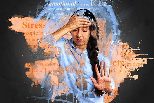 lady holding her head and words related ot stress